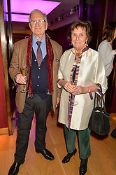 JOHN IRVIN and LADY AMABEL LINDSAY at a lecture featuring Don McCullin talking on War and Peace with Kate Silverton in aid of TUSK at Christie's, 8 King Street, London on 9th December 2015.
