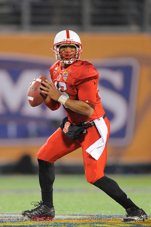 North Carolina State Wolfpack quarterback Russell Wilson (16) in action during the Wolfpack's 23-7 win over the West Virginia Mountaineers in the 2010 Champs Sports Bowl at the Citrus Bowl on Dec. 28, 2010 in Orlando, Florida... ©2010 Scott A. Miller