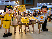 "24 DECEMBER 2015 - BANGKOK, THAILAND: Nok Airlines employees in Santa Claus outfits walk through the new domestic terminal at Don Muang (also spelled Don Mueang) International Airport. The Santa outfits are yellow because that is color Nok uses for its employees' uniforms and planes. The new terminal had its ""soft"" opening Dec. 24. Don Muang is the airport used by low cost airlines serving Bangkok and is now the largest airport in the world for low cost carriers. In 2014, more than 21million passengers used Don Muang. Don Muang International Airport is the oldest airport in Asia and one of the oldest airports in the world. It started functioning as an airfield in 1914.     PHOTO BY JACK KURTZ"