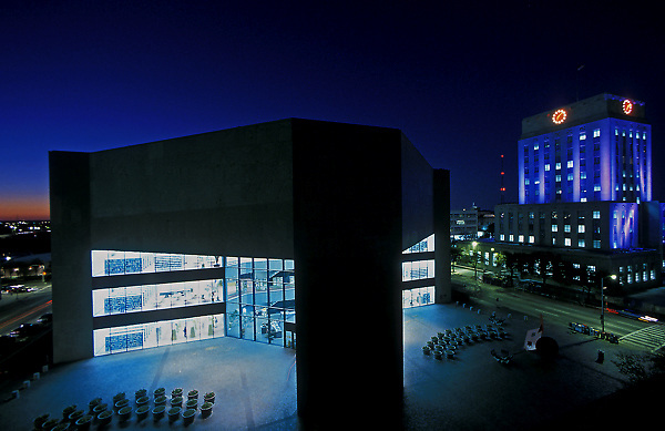 Stock photo of Houston Public Library-Central Library in downtown Houston,Texas on left and Houston City Hall on right at night.