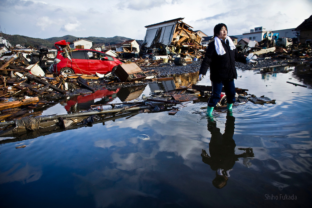 "Chieko Chiba looks for remains of her house in Kesennuma, Miyagi prefecture, Japan, March 16, 2011. ""Everything is gone.""  she said."