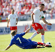 CHORZOW 01/06/2008.POLAND v DENMARK.INTERNATIONAL FRIENDLY.MACIEJ ZURAWSKI OF POLAND IS FOULED BY LARS JACOBSEN OF DENMARK ..FOT. PIOTR HAWALEJ / WROFOTO
