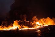 Fires rage at a burning oil well on the outskirts of Qayyara, on December 7, 2016.<br />