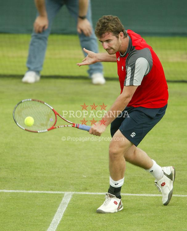 LIVERPOOL, ENGLAND - THURSDAY JUNE 10 2004: Irakli Labadze (GEO) in action during the Liverpool International Tennis Tournament in Claderstones Park. Labadze won 6-7, 6-3, 10-6 (Super tie-break). (Photo by David Rawcliffe/Propaganda)