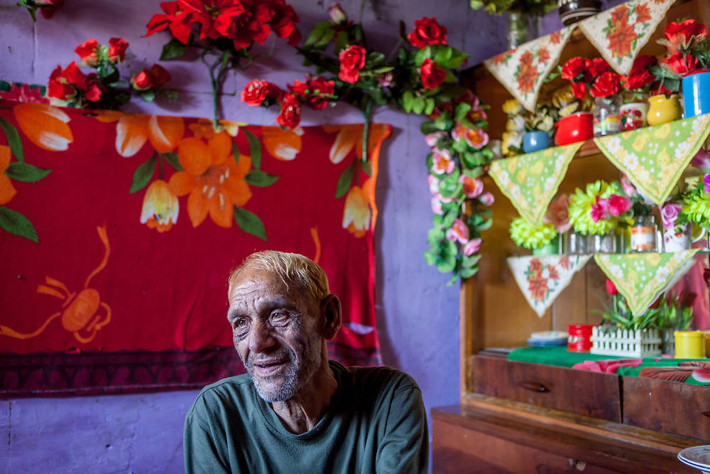 """Portrait of Stephan nicknamed """"Longa"""" in his home at the Roma settlement located at """"Budulovska Street"""" in Moldava nad Bodvou about 30 km from Kosice. A few months later the little house of Stephan was empty, he passed away in the end of 2014 by a serious illness."""