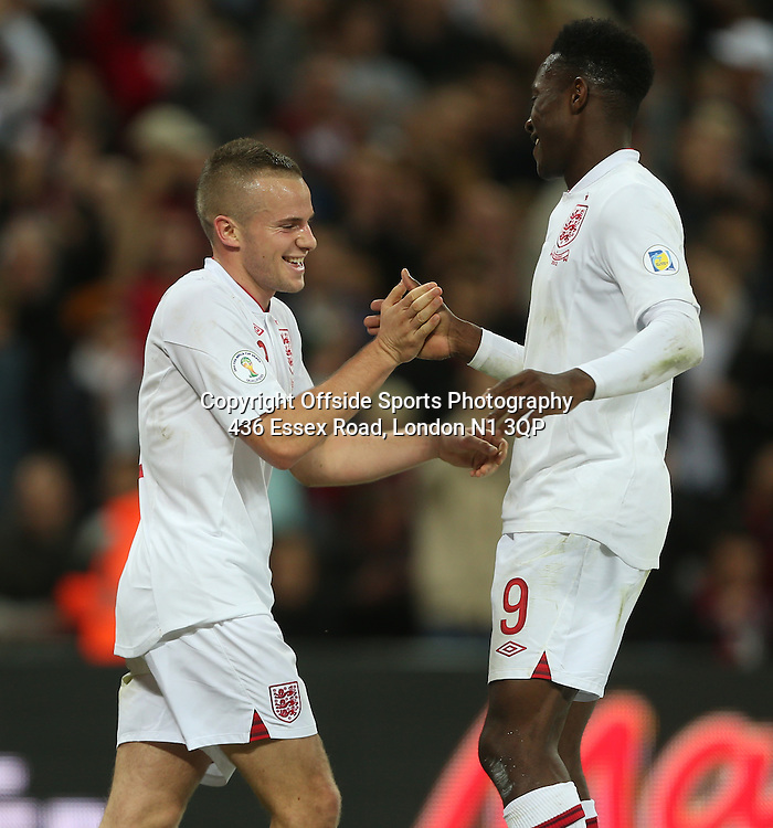 12 October 2012 Football International. England v San Marino.<br /> Tom Cleverly celebrates with goalscorer Danny Welbeck.
