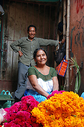"MEXICO, Veracruz, Tantoyuca, Oct 27- Nov 4, 2009. Flower vendors in Huejutla's main ""mercado"" with their colorful offerings. ""Xantolo,"" the Nahuatl word for ""Santos,"" or holy, marks a week-long period during which the whole Huasteca region of northern Veracruz state prepares for ""Dia de los Muertos,"" the Day of the Dead. For children on the nights of October 31st and adults on November 1st, there is costumed dancing in the streets, and a carnival atmosphere, while Mexican families also honor the yearly return of the souls of their relatives at home and in the graveyards, with flower-bedecked altars and the foods their loved ones preferred in life. Photographs for HOY by Jay Dunn."