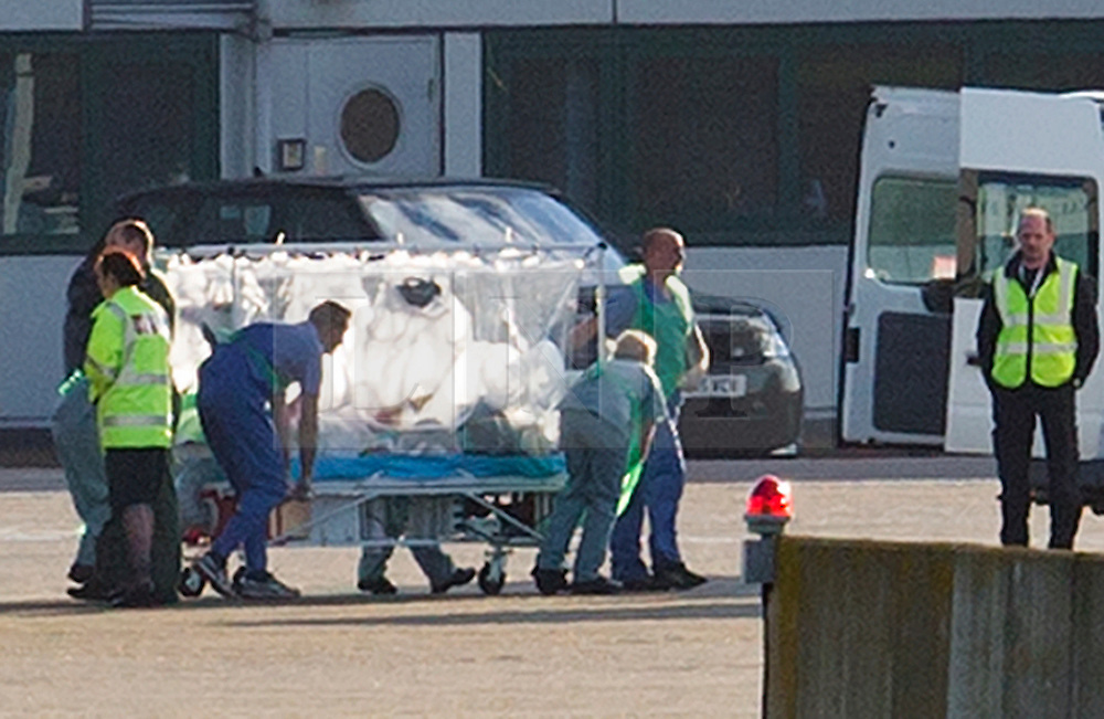 © Licensed to London News Pictures. 23/02/2016. London, UK. Nurse Pauline Cafferkey is taken from an RAF Hercules plane at RAF Northolt.  The Scottish nurse contracted the Ebola virus in Sierra Leone in 2014 and has been admitted to the Royal Free hospital in London with the condition twice before .  Photo credit: Peter Macdiarmid/LNP