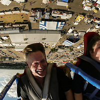 Friends Rob Mann, left, and Garrett Davis, 14, ride the Ejection Seat during the Permian Basin Fair & Exposition Sept. 13, 2008, at the Ector County Coliseum in Odessa, Texas. Riders strapped to the seat are shot about 180 feet into the air on the initial release of the bungee cords.