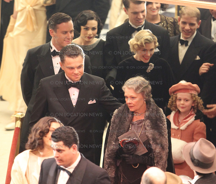 """February 10th 2011  Los Angeles, CA. Non-Exclusive. Leonardo DiCaprio as J Edgar Hoover leaving the recreated 1935 movie premiere of """"G- Men"""". DiCaprio as FBI Director J. Edgar Hoover walks down the red carpet with his Mother played by Judi Dench and is followed by his Associate Director of the FBI and rumored lover, Clyde Tolson played by actor, Armie Hammer. A young actress portraying Shirley Temple was also in the film premiere scene. Shirley Temple and J Edgar Hoover became good friends in real life. After filming was finished for the night, Director Clint Eastwood posed for a few photos with the adorable Shirley Temple actress. She then waved goodbye to the director, actors and crew before leaving. The premiere scene was filmed at the historic Orpheum Theater on Broadway in Downtown LA. Photo by Eric Ford/ On Location News 818-613-3955 info@onlocationnews.com"""