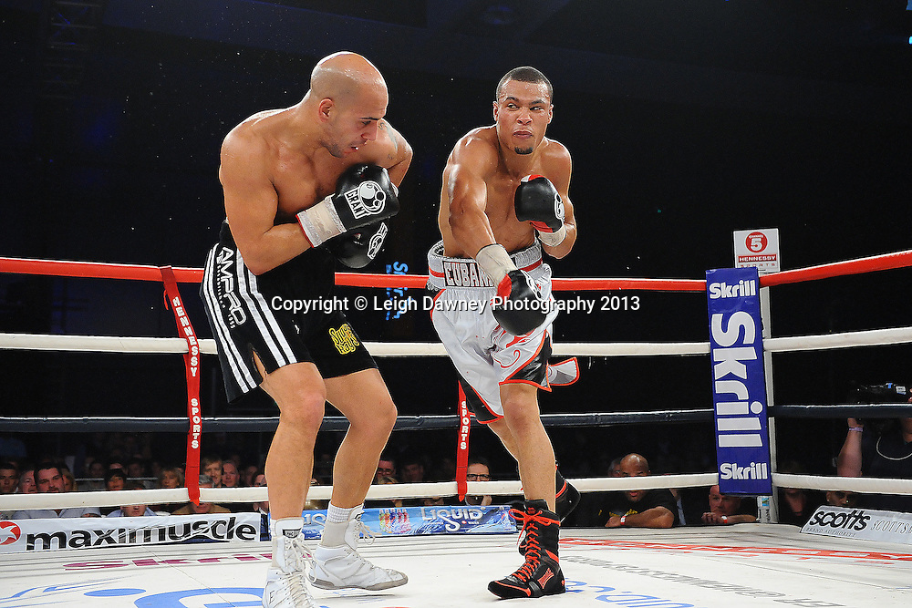 Chris Eubank Jnr (white shorts) boxing Frankie Borg in a Middleweight contest. Glow, Bluewater, Kent, UK. Hennessy Sports © Leigh Dawney Photography 2013.