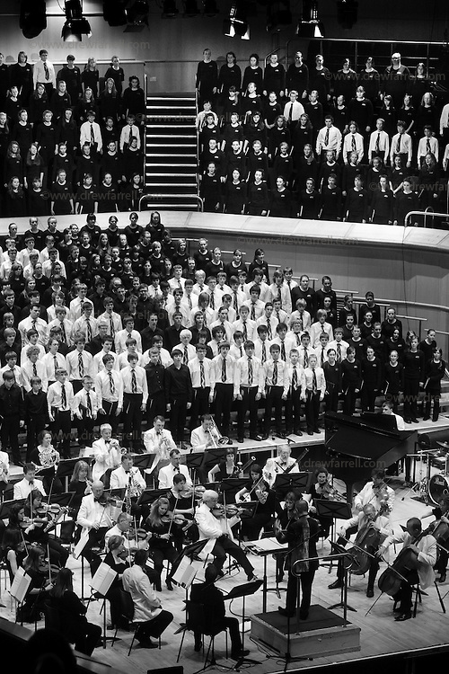 Over 650 singers from nine NYCoS Area Choirs throughout Scotland with the black shirts of the Changed Voice section of NYCoS National Boys Choir, conducted by Christopher Bell  and joined by the Orchestra of Scottish Opera perform Tom Cunningham's specially commissioned 'Seven Planets and a Cosmic Rock ' at The Royal Concert Hall.  Actor Billy Boyd, patron of the National Boys Choir, narrated this section of the show..Glasgow. Sunday 8th May 2011.Picture Drew Farrell.Tel : 07721-735041..Note to Editors:  This image is free to be used editorially in the promotion of the NYCOS. Without prejudice ALL other licences without prior consent will be deemed a breach of copyright under the 1988. Copyright Design and Patents Act  and will be subject to payment or legal action, where appropriate. For further information please contact Vicky Tibbitt Marketing and Communications Manager 0141-287-2801..