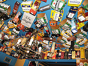 Beer and liquor cartons cover a bar ceiling in Punta Arenas, Chile, South America.