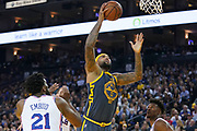 January 31, 2019; Oakland, CA, USA; Golden State Warriors center DeMarcus Cousins (0) shoots the basketball against Philadelphia 76ers center Joel Embiid (21) and guard Jimmy Butler (23) during the third quarter at Oracle Arena.