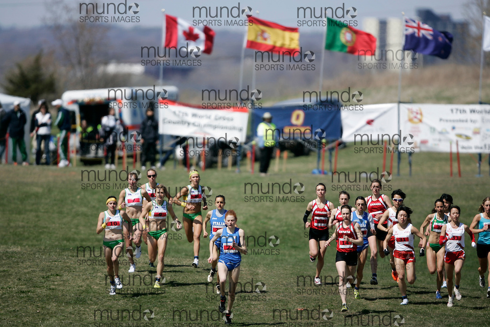 (Kingston, Canada---11 April 2010) \start\ runs in the \women's 5km race\ at the 17th World University Cross Country Championships (FISU) held on the Fort Henry Hill course in Kingston, Ontario, Canada. This photograph is Copyright Geoff Robins / Mundo Sport Images, 2010. For information, go to www.mundosportimages.com or contact info@mundosportimages.com.