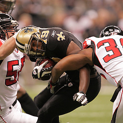 2008 December, 07: Atlanta Falcons defenders Keith Brooking (56) and Lawyer Milloy (36) tackle New Orleans Saints wide receiver Devery Henderson (19) during a 29-25 victory by the New Orleans Saints over NFC South divisional rivals the Atlanta Falcons at the Louisiana Superdome in New Orleans, LA.
