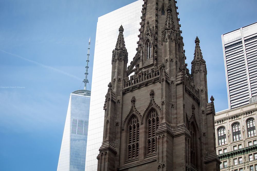 The spear of the Trinity Church. In the background is the spear of the World Trade Center 1, also known as Freedom Tower.