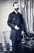 studio portrait man standing late 1800s