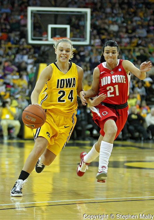 January 08 2010: Iowa guard Jaime Printy (24) drives past Ohio St. guard Samantha Prahalis (21) during the first half of an NCAA womens college basketball game at Carver-Hawkeye Arena in Iowa City, Iowa on January 08, 2010. Iowa defeated Ohio State 89-76.