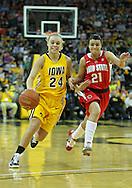 January 08 2010: Iowa guard Jaime Printy (24) drives past Ohio St. guard Samantha Prahalis (21) during the first half of an NCAA womens college basketball game at Carver-Hawkeye Arena in Iowa City, Iowa on January 08, 2010. Iowa defeated Ohio State 89-76.
