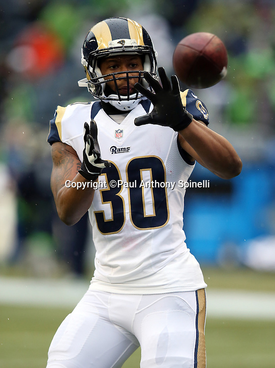 St. Louis Rams running back Todd Gurley (30) catches a pregame pass while warming up before the 2015 NFL week 16 regular season football game against the Seattle Seahawks on Sunday, Dec. 27, 2015 in Seattle. The Rams won the game 23-17. (©Paul Anthony Spinelli)