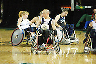 July 7th, 2006: Anchorage, AK - Sean Gabriel speeds away from the White team as White defeated Blue in the gold medal game of Quad Rugby at the 26th National Veterans Wheelchair Games.