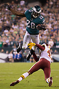 Oct 23, 2017; Philadelphia, PA, USA; Philadelphia Eagles running back Wendell Smallwood (28) leaps with the ball over Washington Redskins cornerback Quinton Dunbar (47) during the second quarter at Lincoln Financial Field. Mandatory Credit: Bill Streicher-USA TODAY Sports