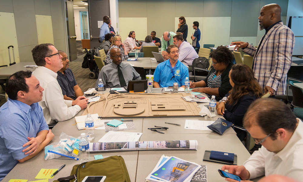 Architects, Houston ISD staff and PAT members discuss options Jordan and Madison High School design charrette at the Houston Food Bank, May 29, 2015.