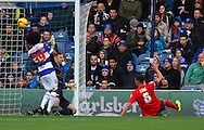 Picture by David Horn/Focus Images Ltd +44 7545 970036<br /> 07/12/2013<br /> Benoit Assou-Ekotto of Queens Park Rangers watches as a shot from Jason Lowe of Blackburn Rovers goes close as is eventually headed off the line during the Sky Bet Championship match at the Loftus Road Stadium, London.
