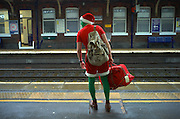 Festive traveller awaits his train at Christmas 2015