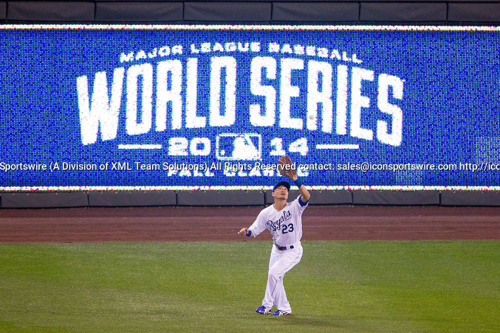 October 22, 2014: Kansas City Royals right fielder Norichika Aoki (23) catches a fly ball in front of the World Series sign during the MLB World Series Game 2 between the San Francisco Giants and the Kansas City Royals at Kauffman Stadium in Kansas City, Missouri.  The Giants lead the series 1-0.  The Royals defeated the Giants 7-2 to tie the series at 1-1