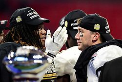 UCF Knights linebacker Shaquem Griffin (L) greets quarterback McKenzie Milton (R) after the second half of the Chick-fil-A Peach Bowl NCAA college football game at the Mercedes-Benz Stadium in Atlanta, January 1, 2018. UCF won 34-27 to go undefeated for the season. (David Tulis via Abell Images for Chick-fil-A Peach Bowl)