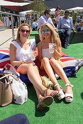 © Licensed to London News Pictures. 07/07/2017. LONDON, UK.  Two friends take a break from their office and enjoy a drink as they watch wimbledon tennis on a big screen at lunchtime near St Paul's Cathedral in London during hot and sunny weather today.  Photo credit: Vickie Flores/LNP