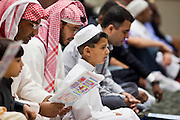 """Sept. 10 - GLENDALE, AZ:  Muslim men pray in the Glendale Civic Center in Glendale, before Eid ul-Fitr services. Muslims from the Phoenix area celebrated Eid ul-Fitr, the end of Ramadan, at the Glendale Civic Center in Glendale, AZ, a suburb of Phoenix. Eid ul-Fitr, often abbreviated to Eid, is the Muslim holiday that marks the end of Ramadan, the Islamic holy month of fasting. Eid is an Arabic word meaning """"festivity"""", while Fitr means """"conclusion of the fast""""; and so the holiday symbolizes the celebration of the conclusion of the month of fasting from dawn to sunset during the entire month of Ramadan. The first day of Eid, therefore, is the first day of the month Shawwal that comes after Ramadan.  Photo by Jack Kurtz"""