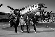 """Commissioned last summer by Women in Aviation International, this image is a """"re-creation"""" of a famous WWII image """"Pistol Packin' Mama.""""    From left to right is commercial airline pilot Stacey Jackson, former Navy aviator and Southwest Airlines Captain Tammy Jo Shults , US Air Force 2-star General Jeannie Leavitt, and LTC Olga Custodio, the first hispanic female pilot in the USAF, and later a commercial pilot for American Airlines.<br /> <br /> Created by aviation photographer John Slemp of Aerographs Aviation Photography. Clients include Goodyear Aviation Tires, Phillips 66 Aviation Fuels, Smithsonian Air & Space magazine, and The Lindbergh Foundation.  Specialising in high end commercial aviation photography and the supply of aviation stock photography for advertising, corporate, and editorial use."""