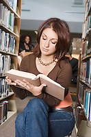 College Student Reading in the Library