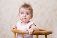 Baby boy sitting on high chair portrait