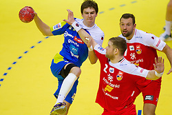 Sebastian Skube of Slovenia vs Vignir Svavarsson of Iceland and Sverre Jakobsson of Iceland during handball match between Iceland and Slovenia in  3rd Round of Preliminary Round of 10th EHF European Handball Championship Serbia 2012, on January 20, 2012 in Millennium Center, Vrsac, Serbia.  (Photo By Vid Ponikvar / Sportida.com)