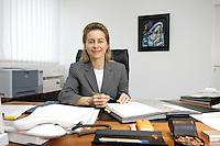 12 DEC 2005, BERLIN/GERMANY:<br /> Ursula von der Leyen, CDU, Bundesfamilienministerin, an ihrem Schreibtisch, in ihrem Buero, Bundesministerium fuer Familie, Senioren, Frauen, und Jugend<br /> Ursula von der Leyen, Federal Minister for family, Seniors, Women and Youth, in her office<br /> IMAGE: 20051212-01-010<br /> KEYWORDS: Büro