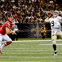 Aug 9, 2013; New Orleans, LA, USA; New Orleans Saints quarterback Drew Brees (9) throws as Kansas City Chiefs linebacker Frank Zombo (51) presssures during the second quarter of a preseason game at the Mercedes-Benz Superdome. Mandatory Credit: Derick E. Hingle-USA TODAY Sports