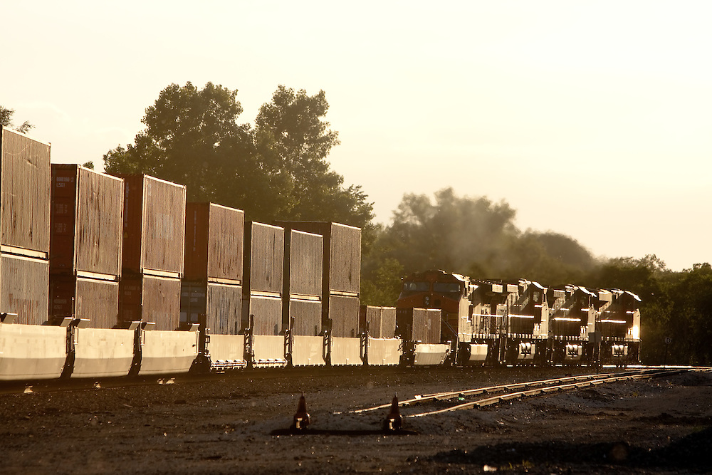 Heading in to the setting sun, a BNSF intermodal train rolls down the rails in East Galesburg, IL.