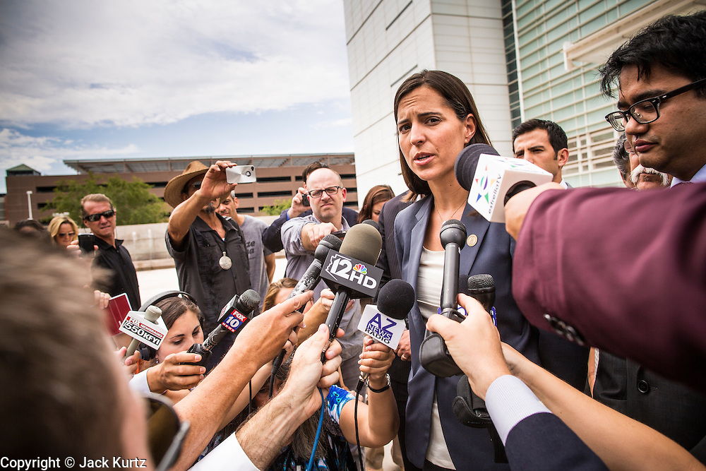 21 AUGUST 2012 - PHOENIX, AZ: KAREN TUMLIN, managing attorney for the National Immigration Law Center, answers reporters' questions at a press conference in front of the US courthouse in Phoenix. A handful of protesters waited outside the Sandra Day O'Connor Courthouse in Phoenix Wednesday while lawyers from the American Civil Liberties Union (ACLU) and Mexican American Legal Defense and Education Fund (MALDEF) sparred with lawyers from Maricopa County and the State of Arizona over the constitutionality of section 2B of SB 1070, Arizona's tough anti-immigrant law. Most of the law was struck down by the US Supreme Court in June, but the Justices let section 2B stand pending further review. The suit is being heard in District  Judge Susan Bolton's court. It was Judge Bolton who originally struck down SB 1070 in 2010. A ruling is expected later in the year.   PHOTO BY JACK KURTZ