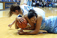 03 March 2013: North Carolina's Krista Gross (21) and Duke's Allison Vernerey (FRA) (43) get tied up with the ball. The Duke University Blue Devils played the University of North Carolina Tar Heels at Cameron Indoor Stadium in Durham, North Carolina in a 2012-2013 NCAA Division I and Atlantic Coast Conference women's college basketball game. Duke won the game 65-58.