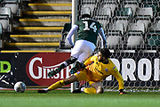 Glenn Morris (1) of Crawley Town makes a save at the feet of Tyreeq Bakinson (14) of Plymouth Argyle to deny him a goal during the EFL Sky Bet League 2 match between Plymouth Argyle and Crawley Town at Home Park, Plymouth, England on 28 January 2020.