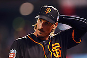 San Francisco Giants pitcher Jeff Samardzija leaves the mound after the fourth inning of the first game of the Battle of the Bay Series against the Oakland Athletics on Thursday, March 31, 2016 in San Francisco, Calif.