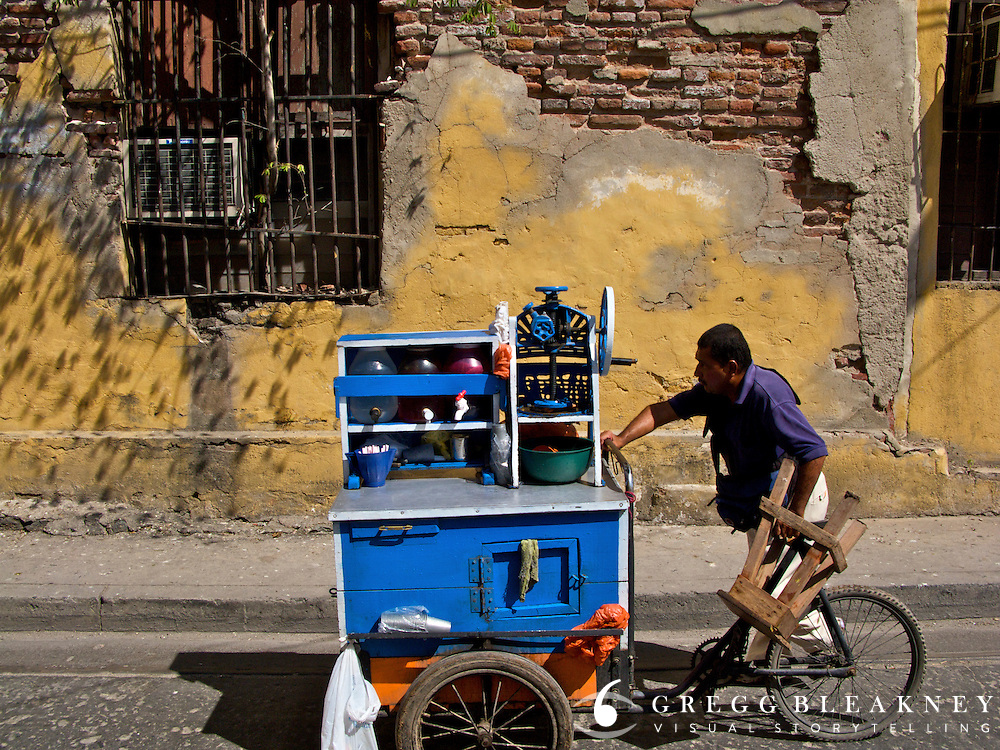 A street vendor makes his way through the coastal town of Santa Marta - Colombia
