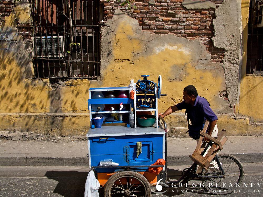 A street vendor makes his way through the coastal town of Santa Marta - Colombia