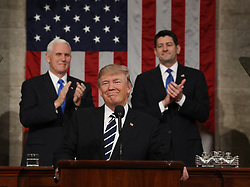 February 28, 2017 - Washington, District of Columbia, U.S. - US Vice President MIKE PENCE (L) and Speaker of the House PAUL RYAN (R) applaud as US President DONALD TRUMP (C) arrives to deliver his first address to a joint session of Congress from the floor of the House of Representatives. Trump asked Congress for help in expanding his agenda. (Credit Image: © Jim Loscalzo/Pool/CNP via ZUMA Wire)