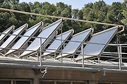 Electricity converting solar panels on a roof of a shed. With the reduction on cost of ownership of these panels, combined with the rise in the cost of electricity have created a positive return on investment on solar electricity. The surplus electricity is sold to the electric company for distribution Photographed in Israel