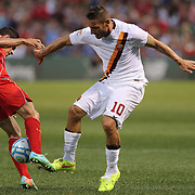 Philippe Coutinho, (left), Liverpool, challenges Francesco Totti, AS Roma, during the Liverpool Vs AS Roma friendly pre season football match at Fenway Park, Boston. USA. 23rd July 2014. Photo Tim Clayton